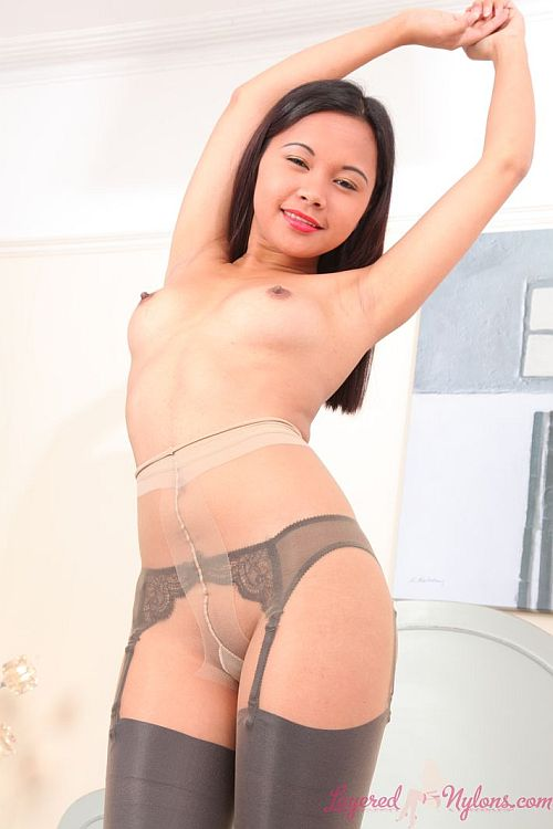 Pretty Sexy Asian Babe In Layer Of Sheer Nylon Pantyhose Over Black Stockings And Garterbelt At Layered-Nylons