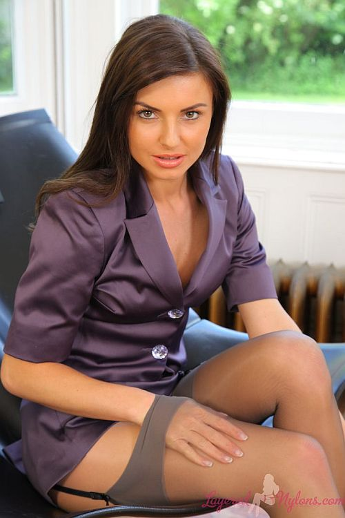 Sexy Brunette Teasing In Layer Of Stockings And Pantyhose