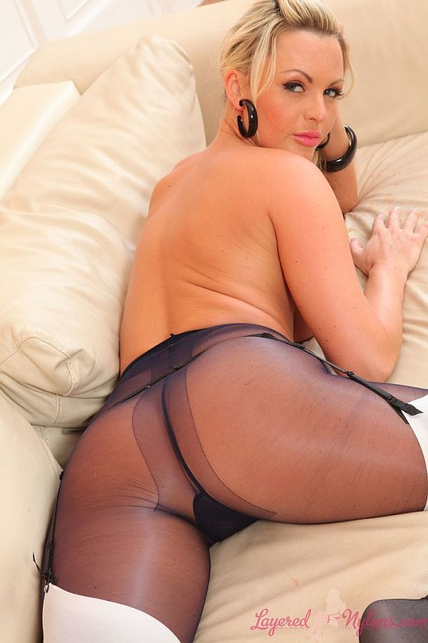 Sexy Blonde Posing With Her Sexy Ass Layered In Black Sheer Nylon Pantyhose And White Stockings At Layered-Nylons