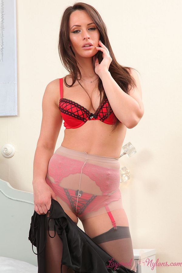 Seductive Brunette Teasing in Layers Of Pantyhose and Stockings At Layered-Nylons