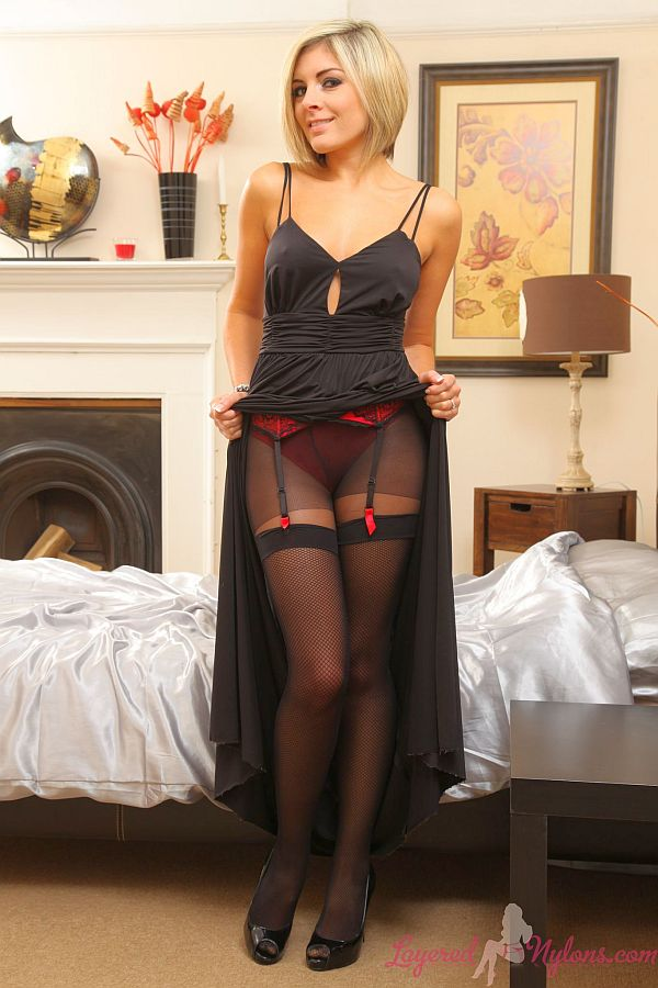 Sexy Blonde Teasing In Layer Of Black Stockings And Suspenders Over Pantyhose At Layered-Nylons