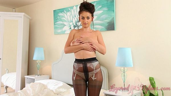 Brunette Model Teasing In Layers Of Lingerie, Black Pantyhose and Tan Stockings Video At Layered-Nylon