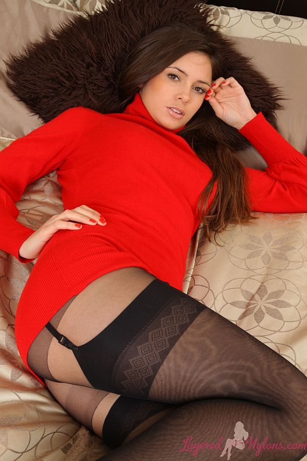 Sexy Brunette Teasing In Sweater and Layers Of Black Nylon Stockings and Pantyhose At Layered-Nylons