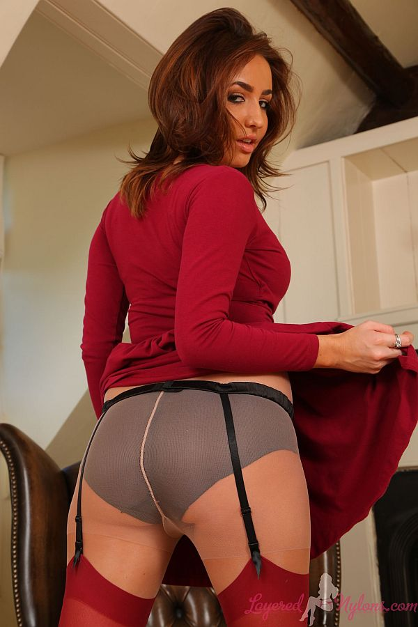 Exotic Brunette Teasing In Layers Of Red Stockings Over Tan Pantyhose At Layered-Nylons