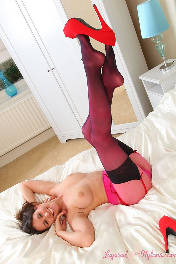 Leggy Brunette Teasing in Layers Of colored Pantyhose and Black Stockings At Layered-Nylons
