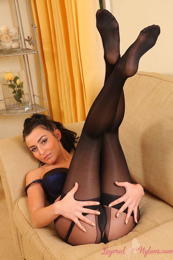 Brunette Showing Off Her Legs and Feet In Layers Of Black Nylon Pantyhose and Stockings At Layered-Nylons