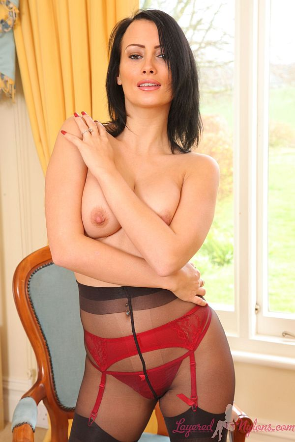 Sexy Topless Brunette Teasing In Layers Of Black Pantyhose and Stockings At Layered-Nylons