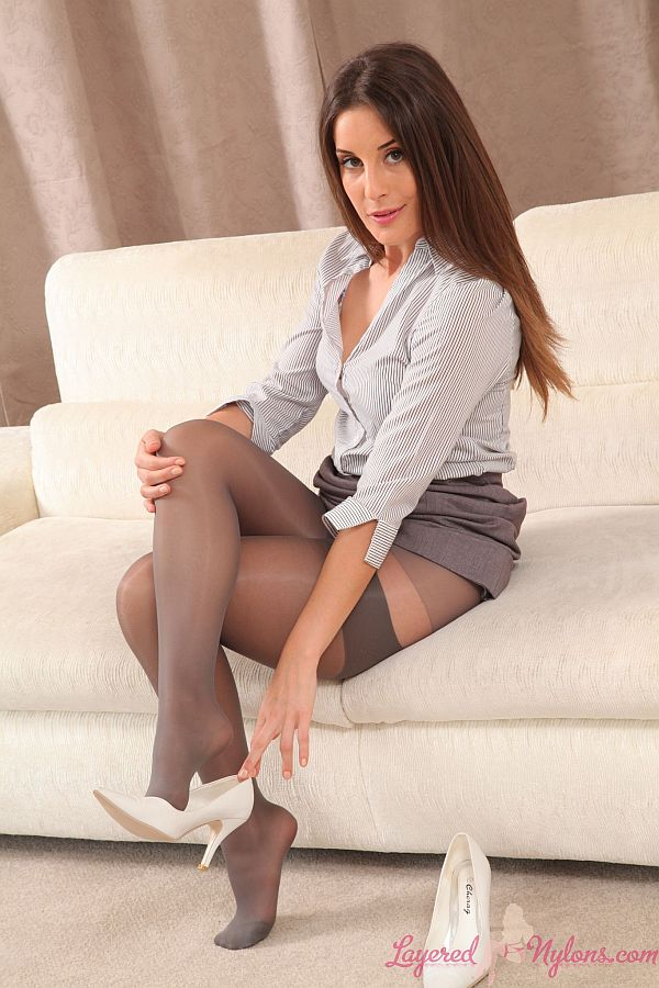 Sexy Brunette Secretary Slips Off Her Heels and Shows Feet In Stockings At Layered-Nylons