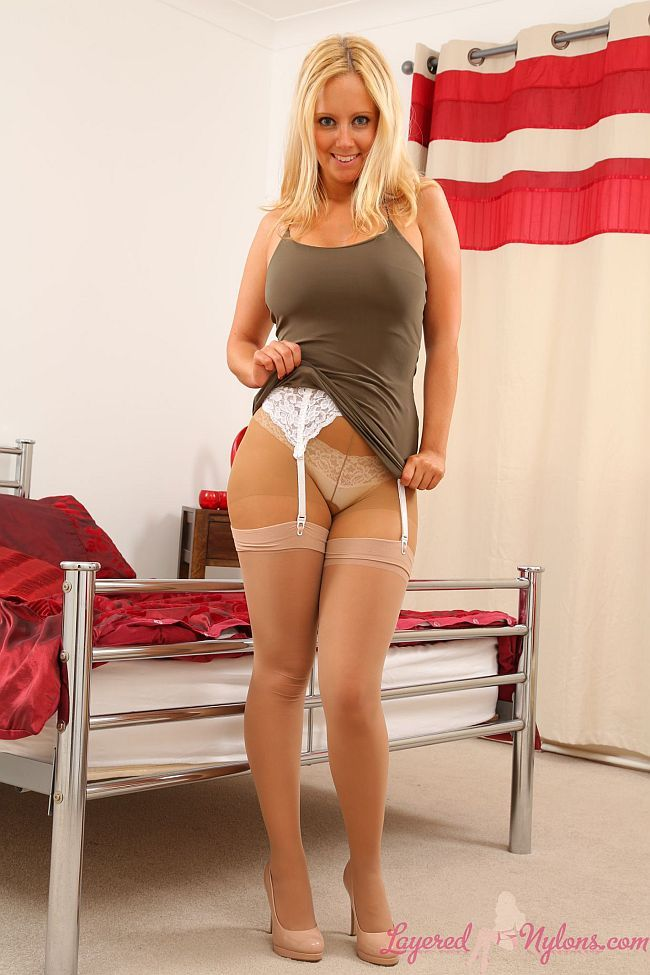 Blonde Babe Teasing In White Lacy Suspender Belt, Panties, Tan-Stockings and Pantyhose at Layered-Nylons