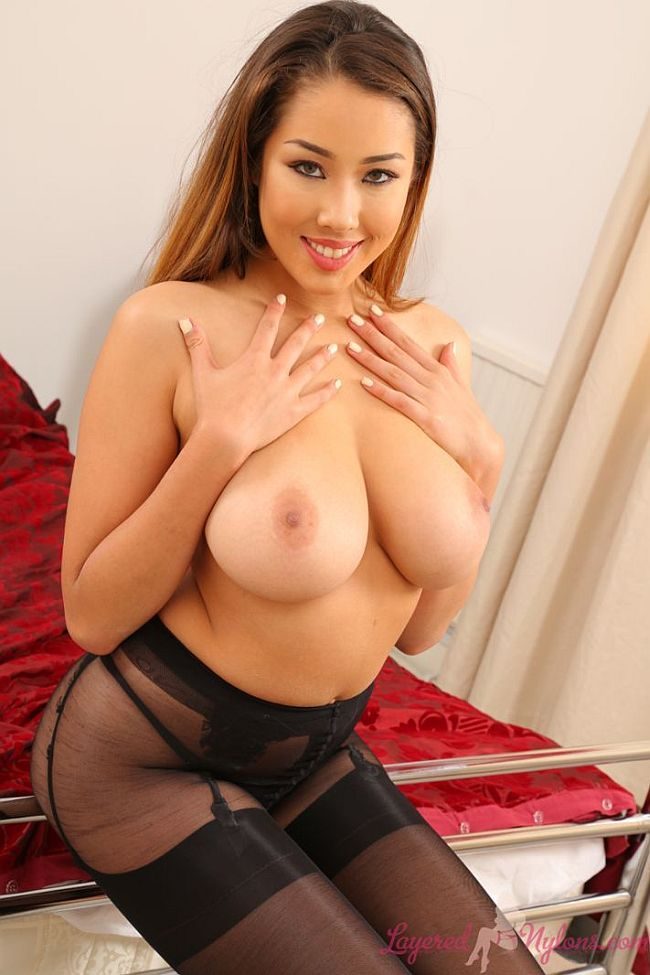 Busty Babe Posing Topless In Black Suspenders, Stockings and Pantyhose at Layered-Nylons