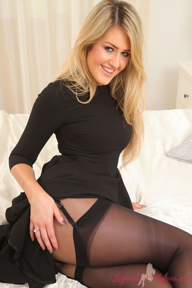 Sexy Blonde Teasing In Black Suspenders, Stockings and Nylon Pantyhose At Layered-Nylons