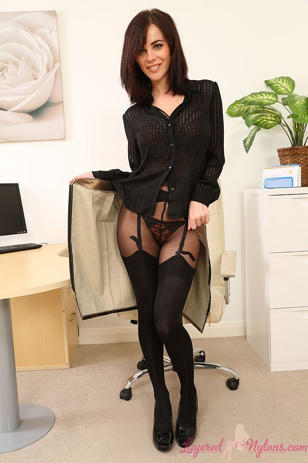 Sexy Secretary Stripteasing In The Office In Suspenders and Stockings at Layered-Nylons