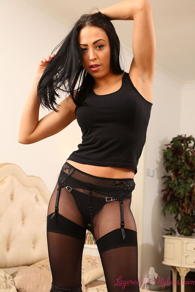Sexy Brunette Teases In Black Panties, Suspenders, Stockings and Pantyhose At Layered-Nylons