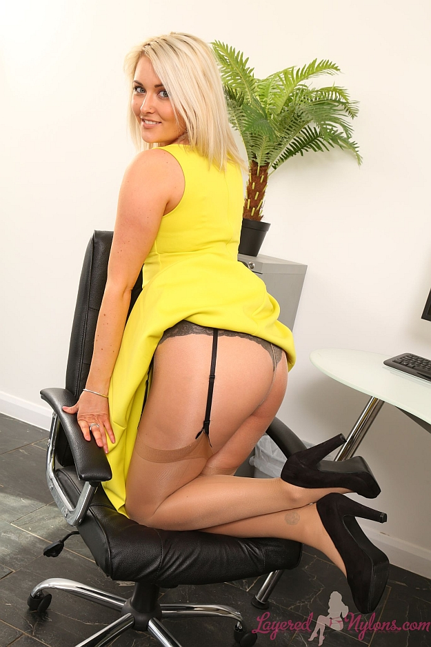 Sexy Blonde Secretary Lifting Her Dress and Teasing In Suspenders, Stockings and Sheer Nylon Pantyhose Layers