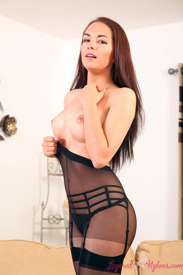 Sexy Brunette Babe Posing Topless In Black Suspenders, Stockings and Pantyhose Layers